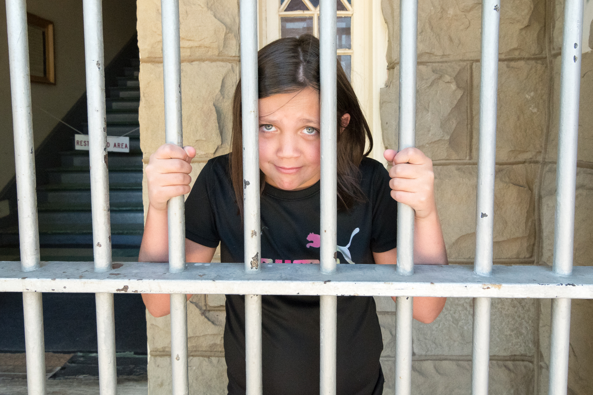 Lily behind bars