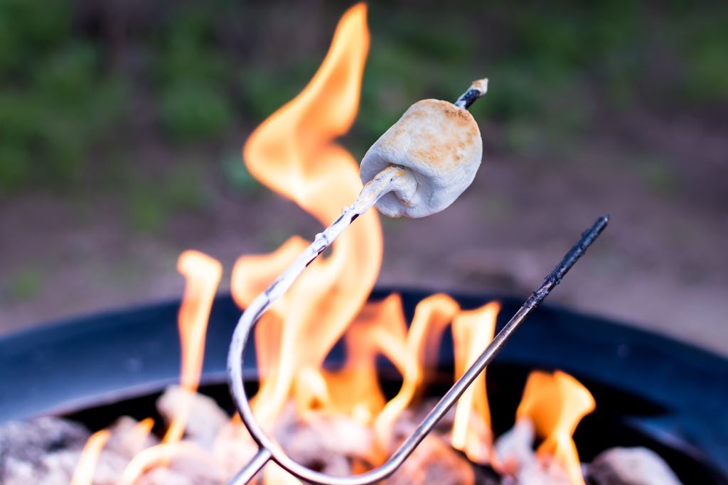 Roasting smores over a gas firepit